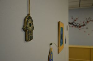 The wall of the then-yet-to-be-opened Takoma Wellness Center featuring hamsas, a traditional Jewish symbol. Photo by Zach C. Cohen.