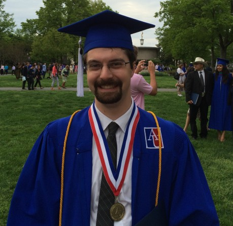 Zach Cohen on the American University quad on Saturday after graduating with a bachelor's degree.